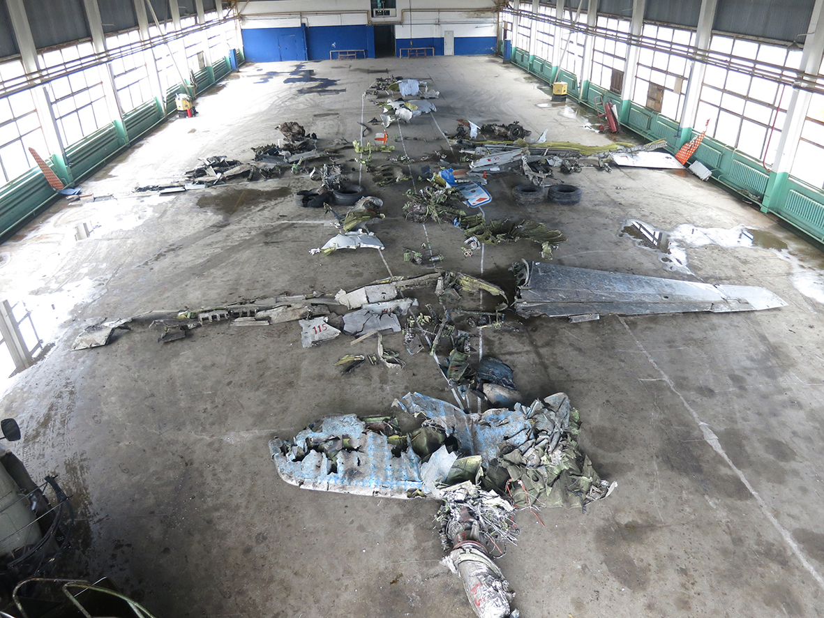 The remains of A6-FDN reassembled in a hangar for the investigation