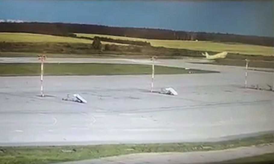 A still from the airport CCTV footage showing the aircraft unsticking beyond the end of the runway
